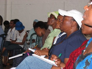 Workers take notes during the evangelism training