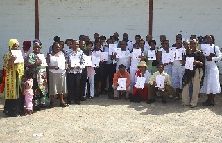 Some of those trained in evangelism show their certificates